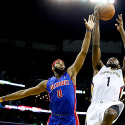 Dec 11, 2013; New Orleans, LA, USA; New Orleans Pelicans point guard Tyreke Evans (1) shoots over Detroit Pistons center Andre Drummond (0) during the second quarter at New Orleans Arena. Mandatory Credit: Derick E. Hingle-USA TODAY Sports