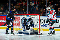 KELOWNA, CANADA - DECEMBER 30: Griffen Outhouse #30 of the Victoria Royals makes a save on a shot by Carsen Twarynski #18 of the Kelowna Rockets on December 30, 2017 at Prospera Place in Kelowna, British Columbia, Canada.  (Photo by Marissa Baecker/Shoot the Breeze)  *** Local Caption ***