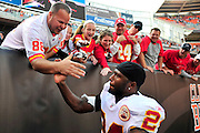 Sept. 19, 2010; Cleveland, OH, USA; Kansas City Chiefs cornerback Brandon Flowers (24) celebrates with fans after a 16-14 win over the Cleveland Browns at Cleveland Browns Stadium. Mandatory Credit: Jason Miller-US PRESSWIRE