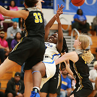 Tupelo's Jalancia Kohlheim gets fouled as she tries to shoot her shot in the second half Thursday night.