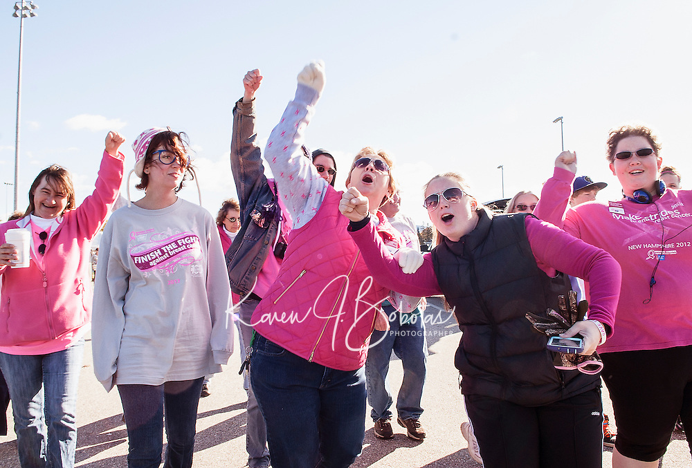 "With the tune ""Sweet Caroline"" playing this group is feeling SO GOOD~ SO GOOD as they leave Opechee Park with Sheila LaBrie during Sunday's Making Strides Against Breast Cancer walk.  LaBrie is a 13 year (and counting) breast cancer survivor.   (Karen Bobotas/for the Laconia Daily Sun)"