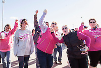 """With the tune """"Sweet Caroline"""" playing this group is feeling SO GOOD~ SO GOOD as they leave Opechee Park with Sheila LaBrie during Sunday's Making Strides Against Breast Cancer walk.  LaBrie is a 13 year (and counting) breast cancer survivor.   (Karen Bobotas/for the Laconia Daily Sun)"""