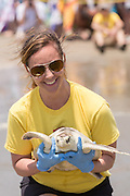 A volunteer prepares to return a rehabilitated Kemp's Ridley sea turtle back into the Atlantic ocean during the release of rescued sea turtles May 14, 2015 in Isle of Palms, South Carolina. The turtles were rescued along the coast and rehabilitated by the sea turtle hospital at the South Carolina Aquarium in Charleston.