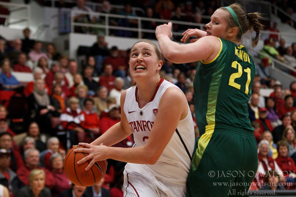 February 26, 2011; Stanford, CA, USA;  Stanford Cardinal forward Mikaela Ruef (3) is defended by Oregon Ducks guard/forward Victoria Kenyon (21) during the second half at Maples Pavilion.  Stanford defeated Oregon 99-60.