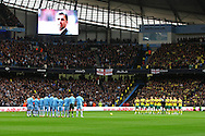 Picture by Paul Chesterton/Focus Images Ltd.  07904 640267.03/12/11.Both teams take part in a minutes applause for Gary Speed before the Barclays Premier League match at the Etihad Stadium, Manchester.