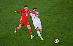 CARDIFF, WALES - Friday, September 6, 2019: Wales' Harry Wilson (L) and Azerbaijan's Gara Garayev during the UEFA Euro 2020 Qualifying Group E match between Wales and Azerbaijan at the Cardiff City Stadium. (Pic by Paul Greenwood/Propaganda)