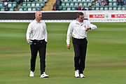 Umpires Alex Wharf and Rob Bailey walk off the outfield after the pitch inspection with play due to start at 12pm after rain delayed the start during the Specsavers County Champ Div 1 match between Somerset County Cricket Club and Essex County Cricket Club at the Cooper Associates County Ground, Taunton, United Kingdom on 26 September 2019.
