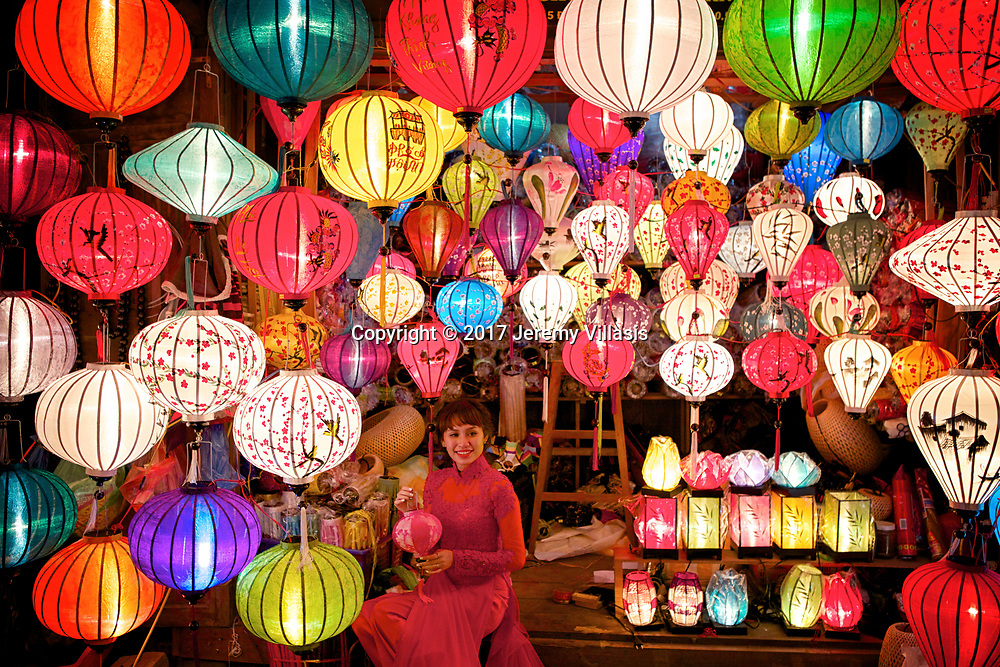 Woman at a lantern shop during Hoi An's Lantern festival held every month during the full moon.
