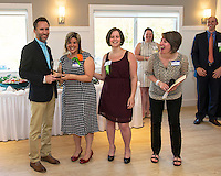 Laura Brusseau (2nd from left) was presented the 2015 Fusion Impact Award from Michael Seymour, Jaimie Sousa and Carmen Lorentz at the Laconia Country Club on Thursday evening.  John Walker and Kyysten Adel also received the Impact Award.    (Karen Bobotas/for the Laconia Daily Sun)