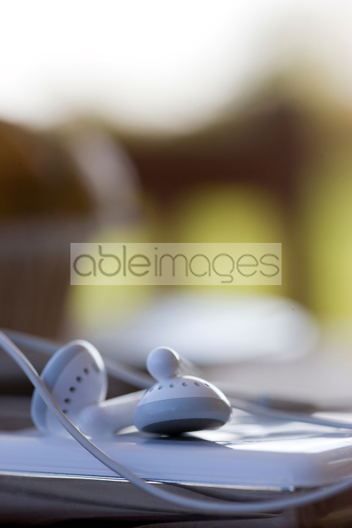 Extreme close up of earphones and portable audio player