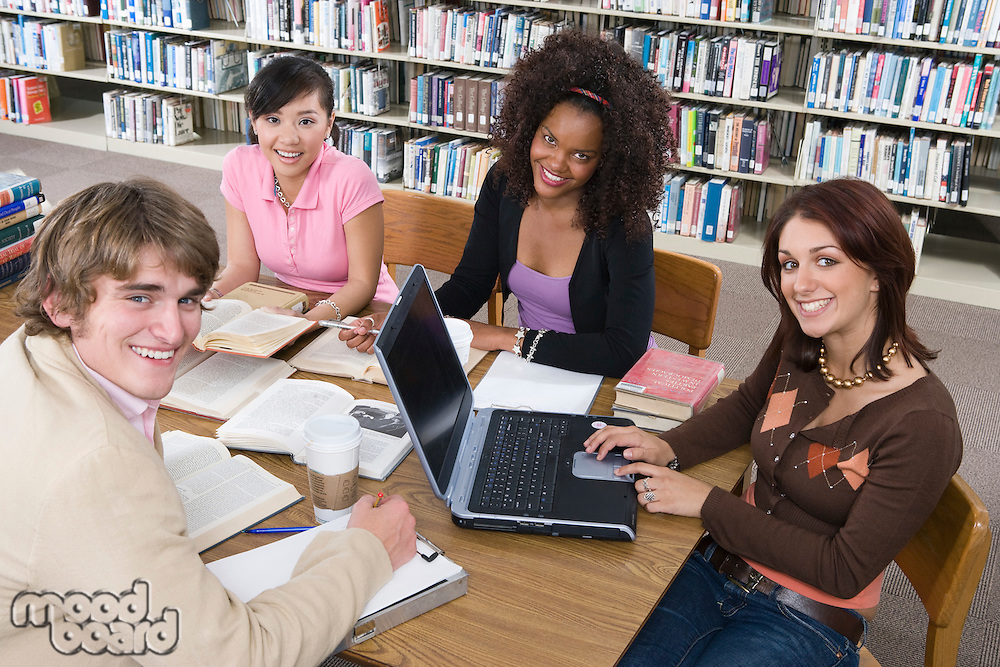 Four University students studying in library