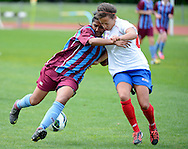 Norinda Kaur of Football South and Sarah Gregorius of Auckland football compete to gain possession, in the ASB women's league match between Football South and Auckland Football, at the Caledonian Ground, Dunedin, New Zealand,  20 October 2013. Credit: Joe Allison / allisonimages.co.nz