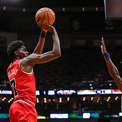 Oct 3, 2017; New Orleans, LA, USA; Chicago Bulls guard Justin Holiday (7) shoots over New Orleans Pelicans guard Jrue Holiday (11) during a NBA preseason game at the Smoothie King Center. The Bulls defeated the Pelicans 113-109. Mandatory Credit: Derick E. Hingle-USA TODAY Sports