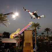 LAS VEGAS, NV, April 6 2006: Skateboarding pro Danny Way skates on the huge half pipe after setting a new Guinness World Record by jumping off the Fender Guitar at the Hard Rock Hotel in Las Vegas, Nevada on April 6, 2006. The record was for Freefall World Record on skateboard. He fell 28 feet and landed on a ramp. The height of the drop from the guitar from the ground was 78 feet. Danny completed the trick twice. (Photo by Todd Bigelow/Aurora)