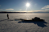 ..Sasa Samson, age 37, the best Inuit hunter in the Inuit town of Resolute Bay, Canada, pulls his sled above the breathing hole of a seal on Tuesday, June 12, 2007. Sasa hunts seals for food, and his community uses every part of the seals, either eating the meat or using the hides to make warm clothes. The traditional way of life in the Resolute Bay Inuit community is being threatened by rising temperatures. The dangers of global warming, which have been extensively documented by scientists, are appearing first, with rapid, drastic effects, in the Arctic regions where Inuit people make their home. Inuit communities, such as those living on Resolute Bay, have witnessed a wide variety of changes in their environment. The ice is melting sooner, depleting the seal population and leaving them unable to hunt the animals for as long. Other changes include seeing species of birds and insects (such as cockroaches and mosquitoes) which they have never encountered before. The Inuit actually lack words in their local languages to describe the creatures they have begun to see. ....