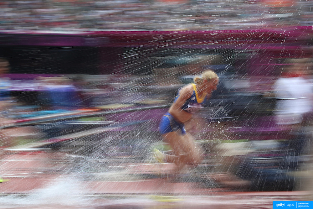 Cristina Casandra, Romania, tackles the water jump during round one of the Women's 3000m Steeplechase at the Olympic Stadium at Olympic Park, during the London 2012 Olympic games. London, UK. 4th August 2012. Photo Tim Clayton