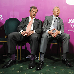 © licensed to London News Pictures. LONDON UK. 27/04/11. (L-R)  Nigel Farage and Alan Johnson listen to Caroline lucas' speech. A News conference held today (27 April 2011) in Church House, London. The conference was introduced by Katie Ghose with Lib Dem President Tim Farron, Green Party Leader Caroline Lucas, UKIP leader Nigel Farage and  Labour's  Alan Johnson, supporting a Yes for the Alternative Vote. Photo credit should read Stephen Simpson/LNP