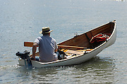 A clinker dinghy powered by a 1.5 Horse power Seagull outboard engine.