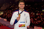 Andrew Pozzi of Great Britain poses with his gold medal won in the Mens 60m Hurdles Final at the  IAAF World Indoor Championships day four at the National Indoor Arena, Birmingham, United Kingdom on 4 March 2018. Photo by Martin Cole.