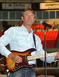 """08 August 2017 - Various - Glen Campbell, the voice behind 21 Top 40 hits including """"Rhinestone Cowboy,"""" """"Wichita Lineman"""" and """"By the Time I Get to Phoenix,"""" died Tuesday. He was 81. During a career that spanned six decades, Campbell sold over 45 million records. In 1968, he outsold the Beatles. Campbell was married four times, and has five sons and three daughters. In the early 1980s, while battling alcoholism and cocaine addiction, Campbell made tabloid headlines with a 15-month, high-profile relationship with country singer Tanya Tucker, who was 22 years his junior. In 1981, he became a born-again Christian and in 1982 he married Kimberly Woollen, a Radio City Music Hall Rockette. In 2003, he was arrested for a hit-and-run, an incident that ended with him allegedly kneeing a police officer in the thigh right before he was released. Campbell pleaded guilty to extreme drunken driving and leaving the scene of an accident, and spent 10 days in jail. In 2011, Campbell, then 75, revealed that he was diagnosed with Alzheimer's disease. In June of that year, he announced he was retiring from music due to the disease. He released his final album of original music Ghost and embarked on a farewell tour with three of his children backing him. File Photo: June 13, 2004; Nashville, TN, USA; Singer GLEN CAMPBELL during the 2004  CMA Music Festival held at the Coliseum. Glen Campbell, who pleaded guilty last month to extreme drunken driving and leaving the scene of an accident, had his sentence delayed so he could perform Sunday at the CMA Music Festival. Photo Credit: Photo: Laura Farr/AdMedia *** Please Use Credit from Credit Field ***"""