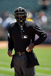 OAKLAND, CA - MAY 27:  MLB umpire Alan Porter #64 stands on the field before the game between the Oakland Athletics and the Detroit Tigers at O.co Coliseum on May 27, 2015 in Oakland, California. The Detroit Tigers defeated the Oakland Athletics 3-2. (Photo by Jason O. Watson/Getty Images) *** Local Caption *** Alan Porter