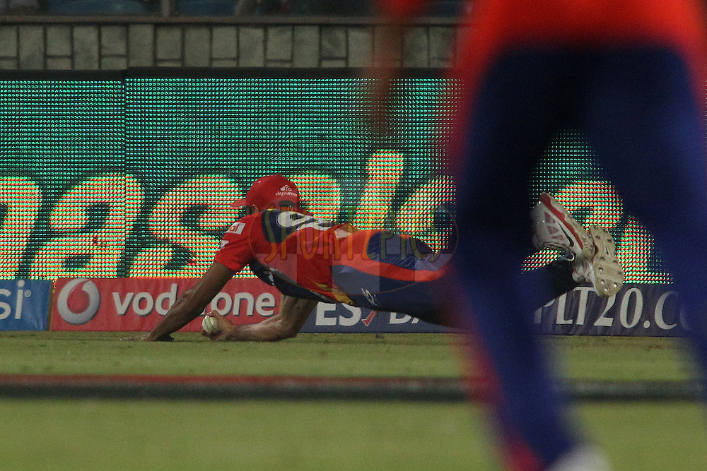 Imran Tahir of the Delhi Daredevils takes the catch to get Parthiv Patel of Mumbai Indians wicket during match 21 of the Pepsi IPL 2015 (Indian Premier League) between The Delhi Daredevils and The Mumbai Indians held at the Ferozeshah Kotla stadium in Delhi, India on the 23rd April 2015.<br /> <br /> Photo by:  Shaun Roy / SPORTZPICS / IPL