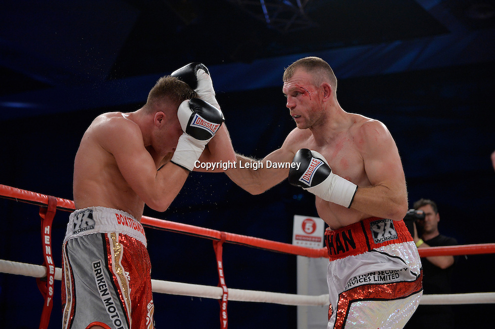 Nick Blackwell defeats Nathan King (right) in a middleweight boxing contest at Glow, Bluewater, Kent on the 8th November 2014. Promoter: Hennessy Sports. © Leigh Dawney Photography 2014.