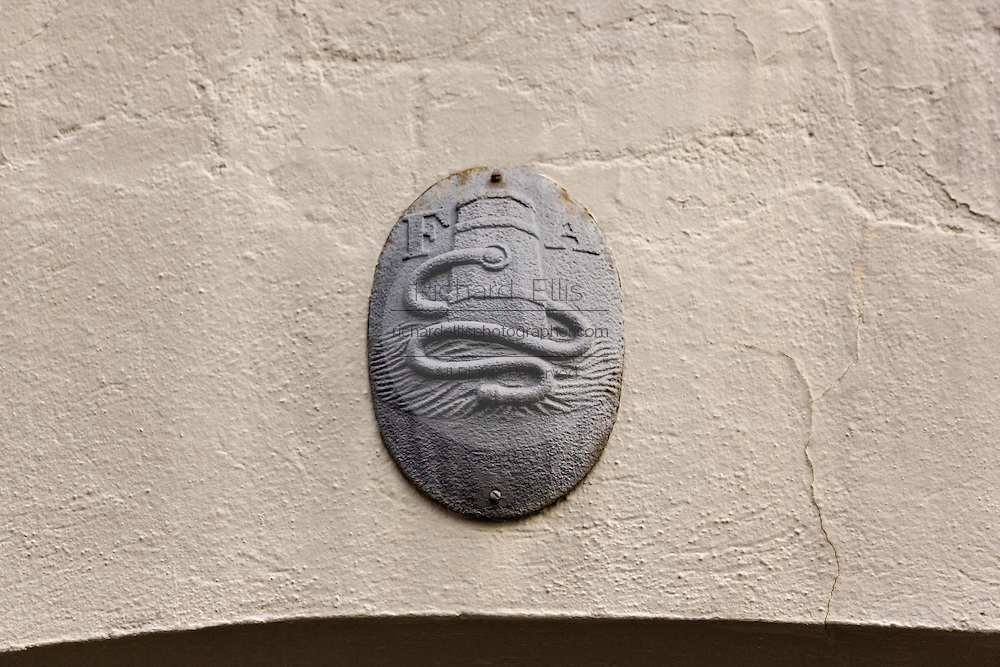 A Fire Insurance mark or plaque on a home in the French Quarter along Queen Street in historic Charleston, SC.