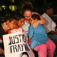 A lady with her children reacts to the not guilty verdict in the George Zimmerman murder trial at the Seminole County Courthouse on Saturday, July 13, 2013, in Sanford, Florida.  Zimmerman had been charged for the 2012 shooting death of Trayvon Martin and was found not guilty by a jury of six women. The protests on the grounds ended peacefully after the verdict was read. (AP Photo/Alex Menendez)