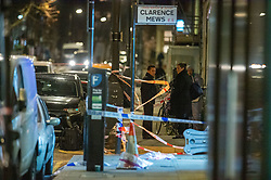 © Licensed to London News Pictures. 05/12/2019. London , UK. Police investigators gather evidence at the scene of a fatal stabbing in Clarence Mews, Hackney. Police were called at 14:01 GMT and attended alongside London Ambulance Service and London's Air Ambulance where they found a man seriously injured. Despite their best efforts the man - believed to be aged in his 20s - was pronounced dead at the scene at 14:33hrs. Photo credit: Peter Manning/LNP