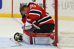 Jan 25, 2013; Newark, NJ, USA; New Jersey Devils goalie Martin Brodeur (30) holds his head after being hit by a shot during the second period at the Prudential Center.