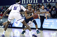 HIGH POINT, NC - JANUARY 06: Charleston Southern's Christian Keeling (11) and High Point's Justyn Mutts (5). The High Point University of Panthers hosted the Charleston Southern University Buccaneers on January 6, 2018 at Millis Athletic Convocation Center in High Point, NC in a Division I men's college basketball game. HPU won the game 80-59.