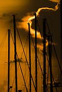 Sail boat masts at sunset