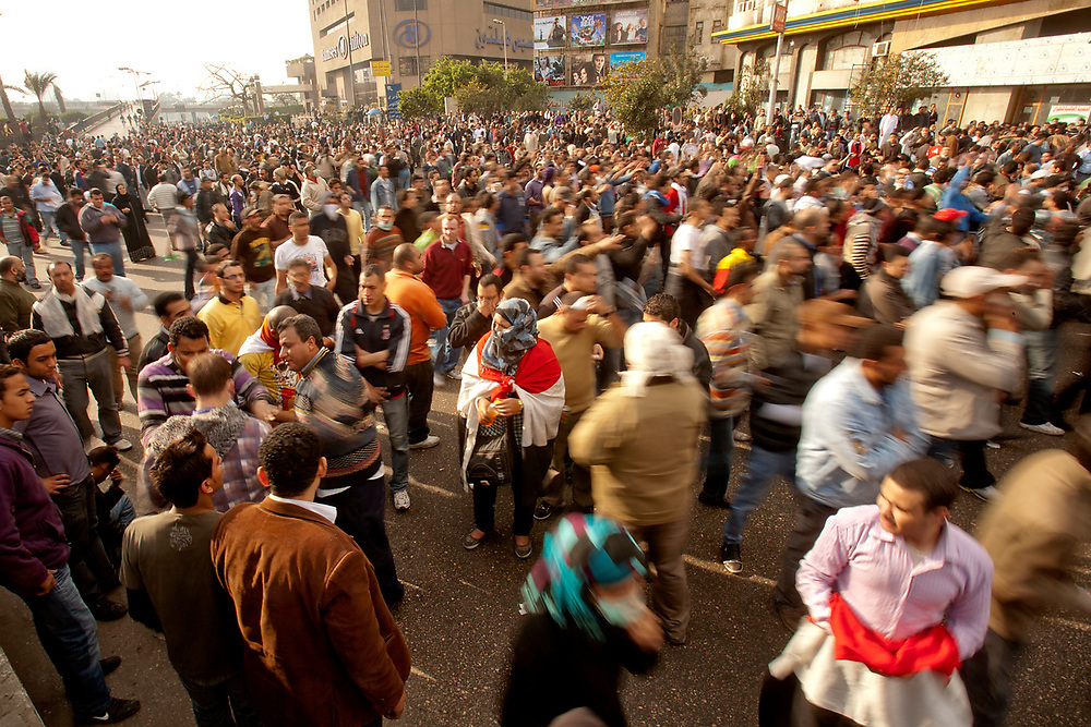 Cairo, Egypt - January 28th, 2011 - Egyptians demonstrate  under the 6th October Bridge at the Corniche on the Nile in downtown Cairo, in a concerted effort to draw attention to past police brutality, poverty and the rising cost of living; in spite of some deaths and many injured caused by police heavyhandedness.  Slogans were shouted against the president of Egypt, Hosny Mubarak; urging his government to step down after being in power for 30 years. Other slogans shouted were calling for peace between Christian and Muslim religions. Photo by Wally Nell/ZUMA