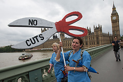 © Licensed to London News Pictures . 20/06/2015 . London , UK . NHS workers on Westminster Bridge . Tens of thousands of people march from the Bank of England to Parliament , to protest economic austerity in Britain . Photo credit: Joel Goodman/LNP
