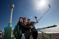UK ENGLAND BRIGHTON 8SEP16 - Emirates cabin crew Sandra Czubak (26) of Poland (with hat), Denise Cetinkava (34, C) of Australia and Kanysmai Abasbekova (23) of Kirgyst take a selfie at the Brighton beach front.<br /> <br /> jre/Photo by Jiri Rezac<br /> <br /> © Jiri Rezac 2016