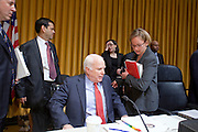 Apr. 20, 2009 -- PHOENIX, AZ: US Senator JOHN MCCAIN (R-AZ) takes his seat at the Senate committee hearing in Phoenix Monday. The US Senate Committee on Homeland Security and Government Affairs, chaired by Sen. Joe Lieberman (Ind-CT), held a hearing about local perspectives on border violence in the Phoenix City Council chambers in Phoenix, AZ, Monday.   Photo by Jack Kurtz