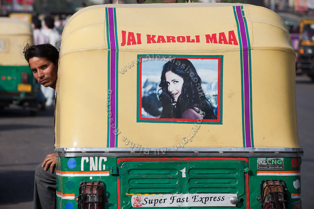A rickshaw driver sits in his vehicle on the streets of Agra. The Taj Mahal has been struggling to keep in shape also because of the high levels of pollution in the city, mainly caused by congested roads and high levels of traffic, vehicles and an increasing population.