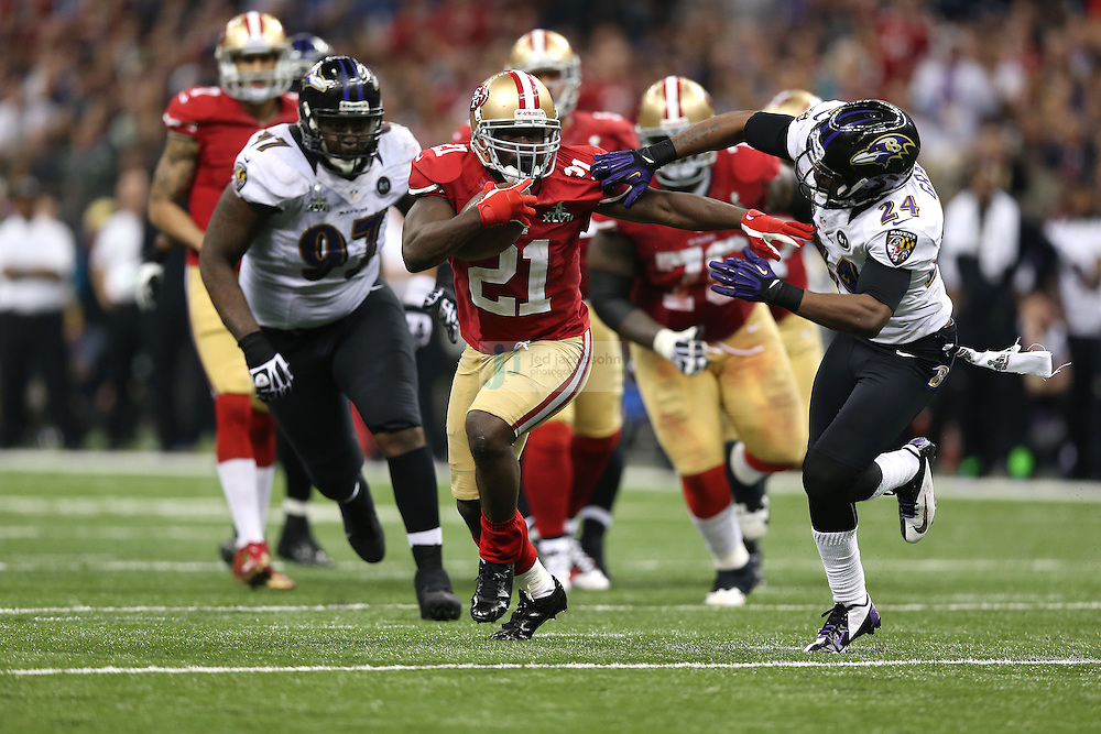 Frank Gore (21) of the San Francisco 49ers in action against the Baltimore Ravens during the NFL Super Bowl XLVII football game in New Orleans on Feb. 3, 2013. The Ravens won the game, 34-31.  (Photo by Jed Jacobsohn)