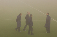 Photo: Paul Thomas.<br /> Liverpool v Arsenal. Carling Cup. 19/12/2006.<br /> <br /> Referee Mike Riley (2nd R) and his Officials call the match off due to fog.