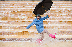 © Licensed to London News Pictures. 12/10/2019. Bristol, UK. MARIE CLIFFORD, age 59 a member of the public from Bristol, does a solo turn after taking part in a flash mob in Bristol city centre doing the dance routine from the classic film musical Singin' in the Rain (1952). The Bristol event is the first event in three major UK cities in the coming weeks, organised by the BFI Film Audience Network. The events are to herald a season of film musicals including re-releases of classic musicals at cinemas and venues across the UK such as Singin' in the Rain (1952), led by BFI, the Independent Cinema Office and Film Hub Midlands. Photo credit: Simon Chapman/LNP.