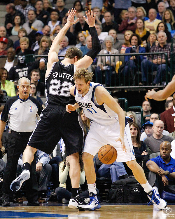 Dallas Mavericks power forward Dirk Nowitzki (41) drives into San Antonio Spurs power forward Tiago Splitter (22) at American Airlines Center in Dallas, Texas, on January 25, 2013.  (Stan Olszewski/The Dallas Morning News)