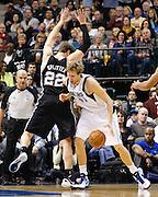 Dallas Mavericks power forward Dirk Nowitzki (41) drives into San Antonio Spurs power forward Tiago Splitter (22) at American Airlines Center in Dallas, Texas, on January 25, 2013.  (Stan Olszewski/The Dallas Morning News)