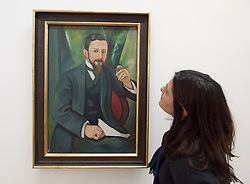 Woman looking at painting Portrait of Author LA Greeven by August Macke at Bonn Kunstmuseum or Art Museum in Germany