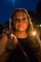 London, June 16th 2017. Local residents and supporters hold a candle-lit vigil at Ladbroke Community Centre just yards from the scene of the Grenfell Tower fire disaster. They were joined by protesters who had marched from Westminster.