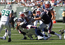 Sept 20, 2009; East Rutherford, NJ, USA;  New England Patriots running back Fred Taylor (21) is tackled after a run during the second half at Giants Stadium. The Jets defeated the Patriots 16-9.