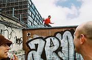 Man dancing on rooftop, Chariot Spa, Fairchild St., Shoreditch, London May 2016.
