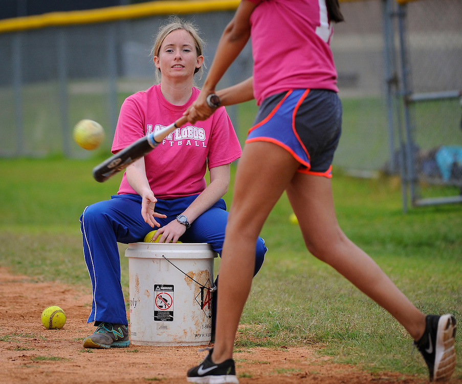 First year teacher Natalie Nelson works with members of the Chavez High School softball team, May 26, 2014.