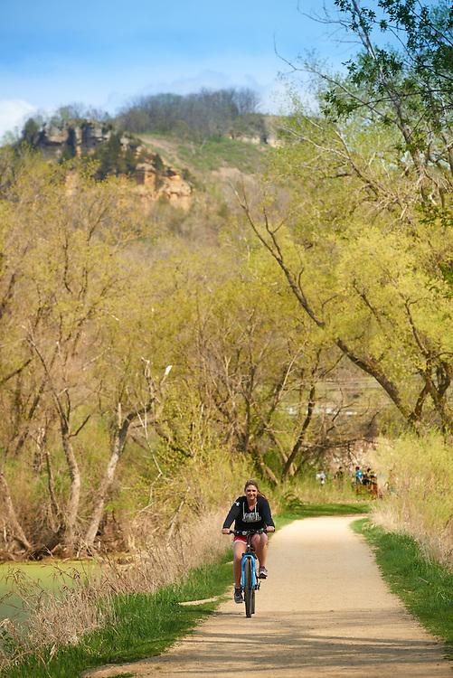 Activity; Biking; Buildings; Bluffs; Marsh; Location; Outside; Objects; Bike; People; Student Students; Woman Women; Spring; April; Time/Weather; day; Type of Photography; Candid; UWL UW-L UW-La Crosse University of Wisconsin-La Crosse