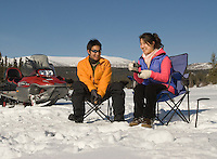 Man and woman ice fishing in the Yukon<br /> <br /> NOT IN YOUR BUDGET? Contact Cathie for a price specific to your project.